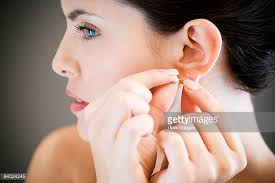 in earrings earring stock photos and pictures getty images