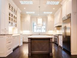 large kitchen with center island white cabinets grey island