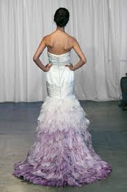 the wedding dress with feathers fit for a fabulous bridal look