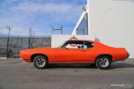 pontiac sports car the first muscle car pontiac gto through the years drivingline