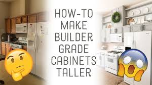 how to make cabinets appear taller how to add height to builder grade cabinets
