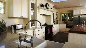 traditional white kitchen featuring floor to ceiling cabinets an