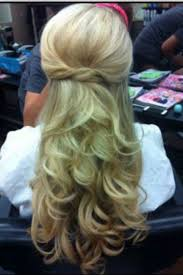 twisted sombre hair a half updo with very loose curls with the sides twisted and