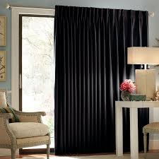 Outdoor Curtain Fabric by Long Black Fabric Curtain On The White Pole For Large Glass Door
