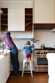 how to turn kitchen cabinets into shaker style farmhouse kitchen adding a shelf below our cabinets