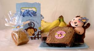 baby shower favor idea decorate wrapped banana bread loaves with