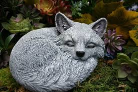 sleeping fox statue outdoor sculpture concrete decor