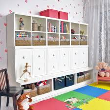 lovely small kids room with multi shelves for storage units