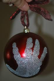 print a child s glttery or foot print on an ornament make