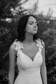 dark haired women black and white dark skinned dark haired girl in a white dress