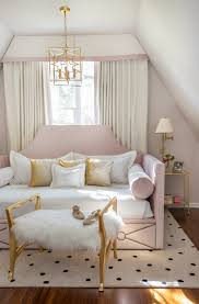 heather gray and pink nursery with devyn tufted upholstered daybed rachel cannon limited interiors sweet teen bedroom featuring a custom made queen sized daybed
