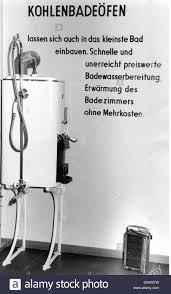 lodging bathroom coal hot water heater exhibition germany stock photo lodging bathroom coal hot water heater exhibition germany 1950s 50s oven hot water bathing shower 20th century