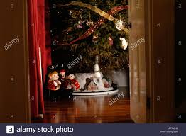 an english christmas tree seen through doorway in victorian house