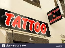 sign outside tattoo shop funchal madeira portugal eu europe stock