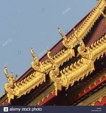 thai buddhist temple roof with golden ornaments thailand stock