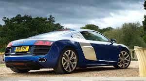 audi r8 wallpaper blue 2009 audi r8 v10 side back pose in blue wallpaper