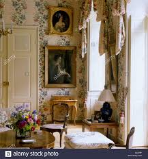 Historic Home Interiors by Drawing Room With Floral Wallpaper And Family Paintings In