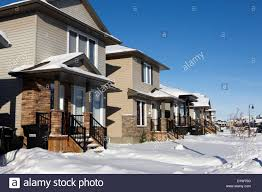 Winter Houses by Suburban Houses Covered In Snow During Bright Crisp Winter Day