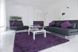 purple livingroom the use of white and black with the accent of purple makes