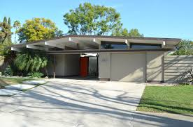 exterior exciting eichler homes with gable roof and garage door