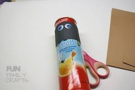 Recycled Halloween Crafts - pringle can mummy recycle a potato chip can this halloween