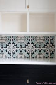 Laundry Room Decorations by White Marble Porcelain Tile Shaw Floors Gold Lantern Chandelier