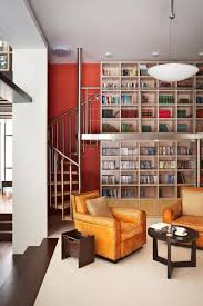 stunning small home library designed using high ceiling concept