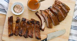 oven roasted ribs with a peachy bourbon bbq sauce designs of any