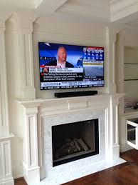 install tv above brick fireplace installation on putting next to