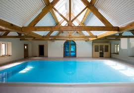 nice indoor swimming pool design with terrific clear glass windows