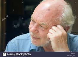 looking with grey hair 70 year old man with grey hair and a beard looking pensive off