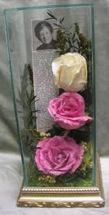 preserved funeral tribute memorial flowers in glass case http