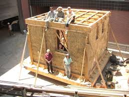 after building a straw bale house the straw is covered with an