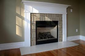 light cream marble mantel covering black fireplace box interior