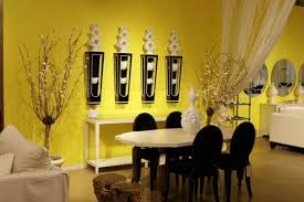 fancy yellow dining room with unique wall decors attractive wall