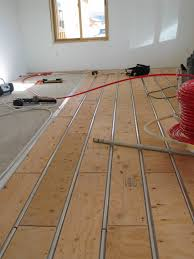 Heated Floor Under Laminate Thermofin U Aluminum Heat Transfer Plates Are Installed Under A