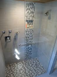 modern waterfall shower with grey wall tile and mosaic grey shower gray ceramic wall panel with glass mosaic accent combined with stainless steel grab bar on glass shower door panel likeable shower designs with glass