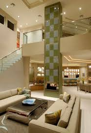 luxury living room with fireplace and high ceiling high ceiling