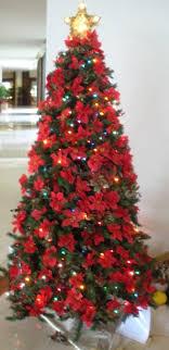 hawaiian themed tree decorated in poinsetta