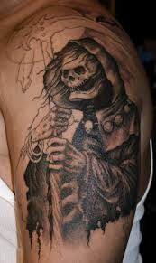 wonderful graveyard tattoo design on the arm photos pictures