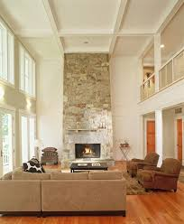 two story stone fireplace living room farmhouse with beige sofa