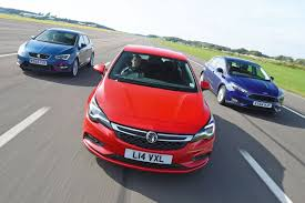 vauxhall ford vauxhall astra vs seat leon u0026 ford focus auto express