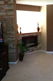 best 25 lowes electric fireplace ideas on pinterest fake stone electric fireplace surrounded by airstone lowe s diy stone was easier than i expected