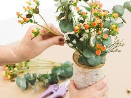 diy tree stump vase filled with flowers hgtv