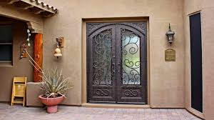 tuscan house with ornate security door exterior security doors