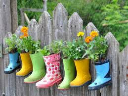 creating unique home ideas in the living room and kitchen home upcycled shoes ideas on rustic wood plank fence smart creative and unique container flower garden ideas