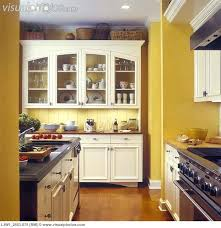 yellow kitchens antique yellow kitchen kitchens yellow walls with custom made white cabinets glass