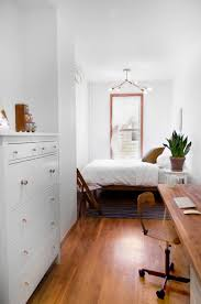 minimalist small bedroom with white walls and houseplant minimalist small bedroom with white walls and houseplant makeover ideas for a small bedroom