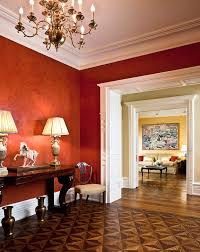 dramatic red walls greet guests in this new york apartment