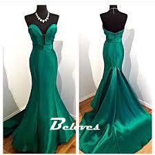 emerald green satin sweetheart mermaid gown with sweep train